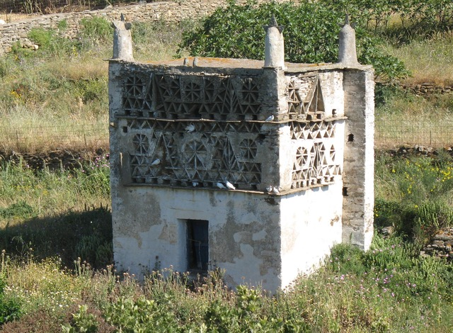 Typical Tinos Dovecotes (Περιστεριώυες)  Showing typical geometric patterns made from local slate slabs