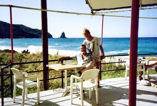 That's me on Corfu with a young Aussie backpacker, working as a bartender from Author Ian Kent